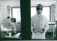 Nurse putting the food in the microwave for the Ronald Marney.