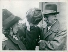 A German detainee with his parents, crying, 1949.