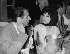 Pascale Petit talking to a man, sitting next to her.