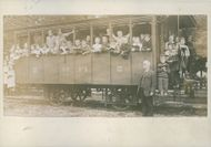 Children gathered inside of the train during the WWI, 1918.
