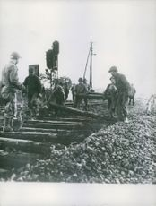 American soldiers replace railroad ties to repair a roadbed in France