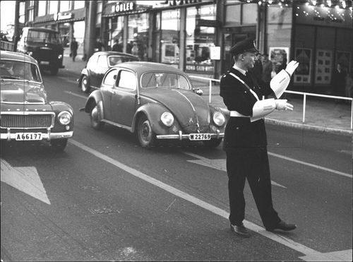 A police officer at work in traffic.