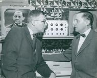 S. Wickbom with Jarl Hjalmarsson, party leader for the moderators, in front of television monitors