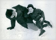 Jack Palance having fun with his son and smiling.
