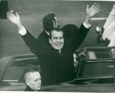 US President Richard Nixon waving from his car after swearing the president of Capitolium