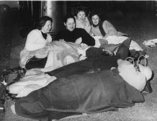 People sleeping on the streets at night.