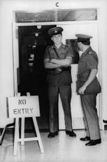 """Two police officers guarding at the door with the signage """"No Entry"""", January 1968."""