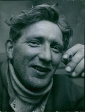 Portrait of a man, smiling and smoking, 1952.