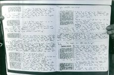 A written paper held by human hand.