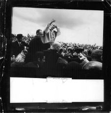 Pope Paul VI standing amidst million of people.