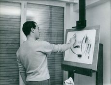 A man sketching on the board. 1963