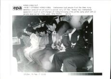 vietnamese boat people from the shek kong detention camp arrive at court in a police lorry 07 feb.