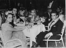 Claudia Cardinale enjoying drinks with friends.