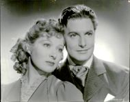 "The actors Robert Donat and Greer Garson photographed together in the movie ""Goodbye, Mr. Chips""."