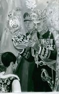 A painting of Yves Brayer of a coronation of the royals.