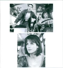 """A photo of Keanu Reeves and Sandra Bullock in a film """"SPEED"""" 1994"""