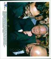 Katsuyuki Sugita surrounded by bodyguards, trying to leave the Ministry of Finance in Tokyo