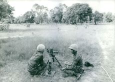 Vietnamese mortar team sitting and waiting.