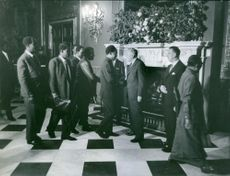 James Harold Wilson standing and meeting people in the hall