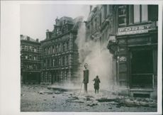In a city of Belgium, after an air bombardment. 1940