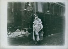 Two soldiers at the train station. 1915.
