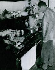A photo of a Canadian actor in film and Television Raymond Burr is in his kitchen stove top.
