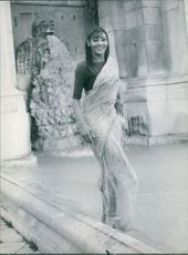 Princess Amina posing in her wet dress, 1962.