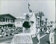 Vintage photo of Miss Belgium in a parade waving to the crowd during the beauty contest in Long Beach. Photo taken on Aug. 15, 1960.