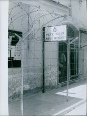 A vintage photo of Police station entrance during Russian war time.