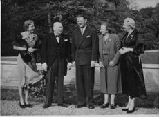 Winston Churchill and his wife Clementine Churchill with friends.