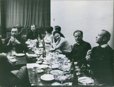 People enjoying meal together. 1968