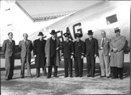 Pilots and passengers standing in front of the new Douglas DC (Douglas Commercial Aircraft), transport aircraft at Bromma.