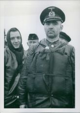 """People standing, facing camera and smiling.  German bevaku cruise """"Vorpost 704"""" due to the brush, Shane.  1940"""