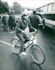 A young lady riding a bicycle.  Taken - Oct. 1964