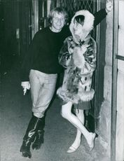 Barry McGuire having discussion with a woman standing next to him and smiling.