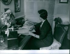 Dona Isabel siting in her office.