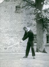 Arnold Palmer, American professional golfer, seen playing golf.