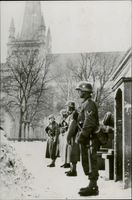 German Soldiers standing near the Catherdral.