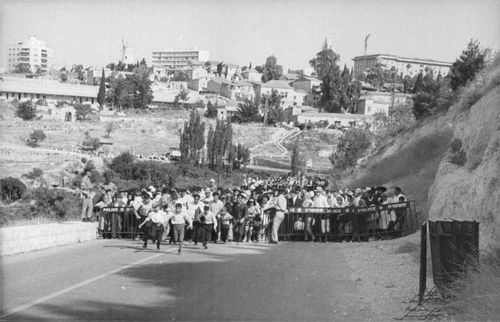 Children running in from a police line in Israel.