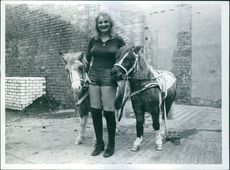 Sheila Stewart standing with pair of horse.