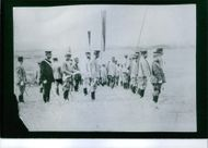 Soldiers and general standing in attention position.