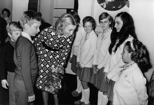 Prince Laurent with his mother meeting other children.