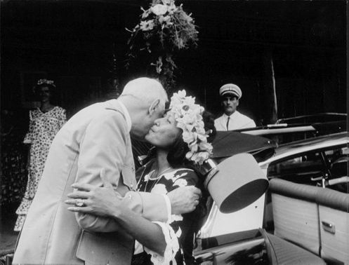 Charles de Gaulle greeted by a lady.
