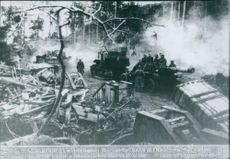 Military tanks in a forest during wartime.