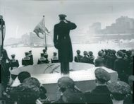 The commander saluting on top of the ship during the endorsement of the HMS Halland ship