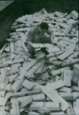 A carload of captured German aluminium ingots examined by an American soldier near Rougemon, France.