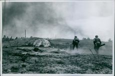 Enemy soldiers attacking during wartime. 1941