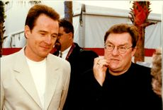 Portrait image of Bryan Cranston and Stephen Root taken in an unknown context.