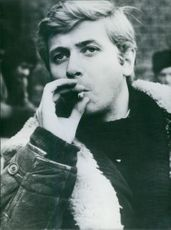 Polish actors Janusz Gajos young actor who has appeared in several prize-winning films posing while smoking. 1967