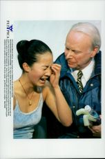Winter Olympics in Nagano in 1998. The artist, Michelle Kwan, reacts after losing the gold to Tara Lipinski. Here with his coach Frank Carroll